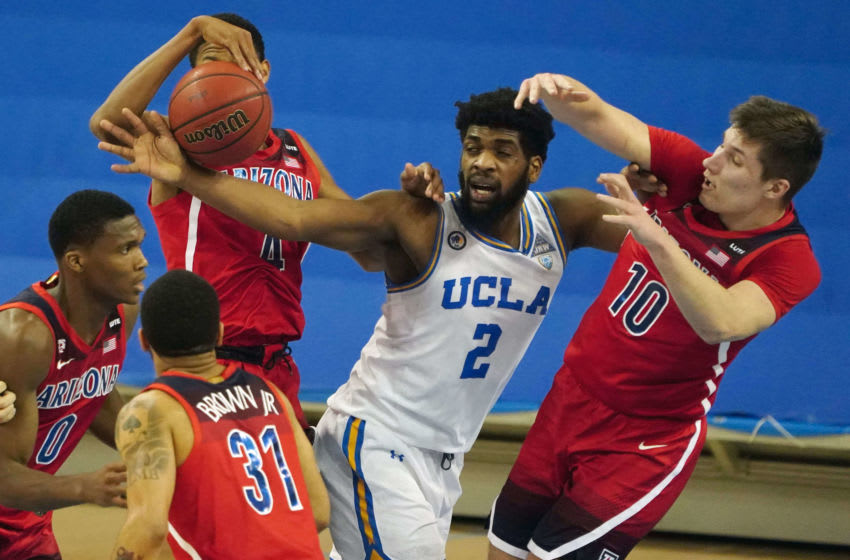 Feb 18, 2021; Los Angeles, California, USA; UCLA Bruins forward Cody Riley (2) battles for the ball with Arizona Wildcats guard Dalen Terry (4) and forward Azuolas Tubelis (10) in the first half at Pauley Pavilion. Mandatory Credit: Kirby Lee-USA TODAY Sports