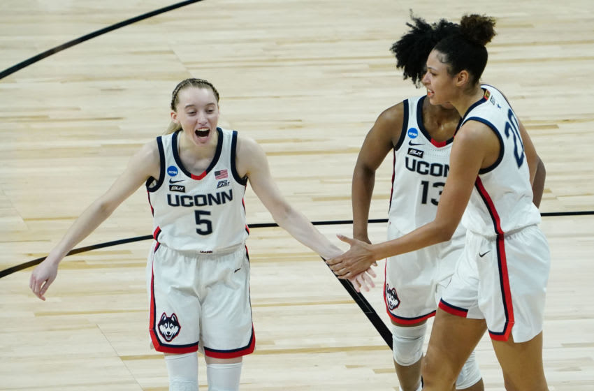 Mar 27, 2021; San Antonio, Texas, USA; Connecticut Huskies players Paige Bueckers (5) , Christyn Williams (13) and Olivia Nelson-Ododa (20) celebrate against the Iowa Hawkeyes in the Sweet Sixteen of the 2021 Women's NCAA Tournament at Alamodome. Mandatory Credit: Kirby Lee-USA TODAY Sports