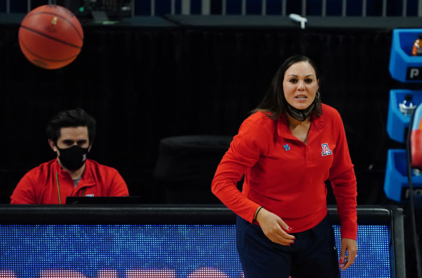 Apr 2, 2021; San Antonio, Texas, USA; Arizona Wildcats head coach Adia Barnes reacts from the sidelines against the UConn Huskies during the first half in the national semifinals of the women's Final Four of the 2021 NCAA Tournament at Alamodome. Mandatory Credit: Kirby Lee-USA TODAY Sports