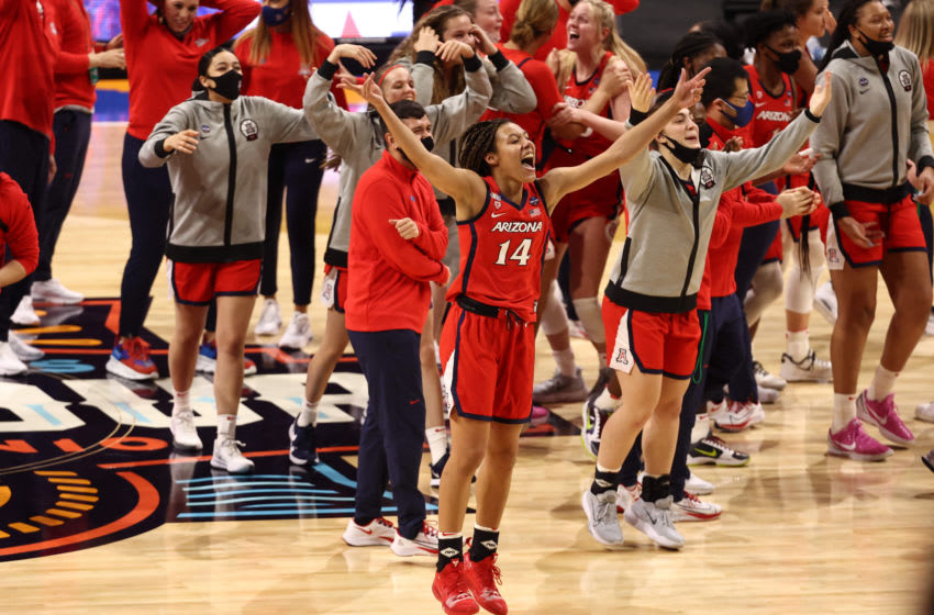 Apr 2, 2021; San Antonio, Texas, USA; Arizona Wildcats forward Sam Thomas (14) celebrates after defeating the UConn Huskies in the national semifinals of the women's Final Four of the 2021 NCAA Tournament at Alamodome. Mandatory Credit: Troy Taormina-USA TODAY Sports