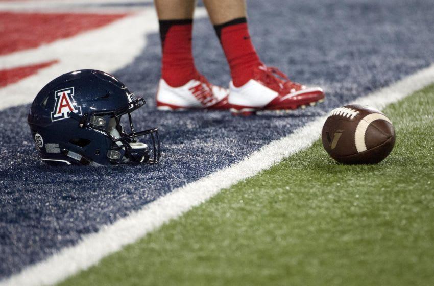 Oct 29, 2016; Tucson, AZ, USA; An Arizona Wildcats helmet on the field before the game against the Stanford Cardinal at Arizona Stadium. Mandatory Credit: Casey Sapio-USA TODAY Sports