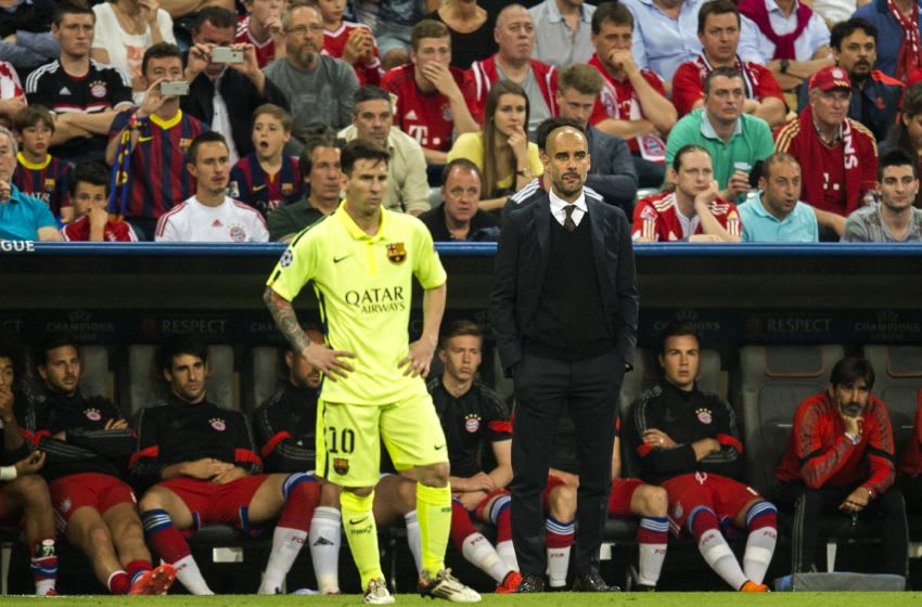 Barcelona's Argentinian forward Lionel Messi (L) and Bayern Munich's Spanish head coach Pep Guardiola stand on the pitch during the UEFA Champions League football match semi final FC Bayern Munich vs FC Barcelona in Munich on May 12, 2015. AFP PHOTO / ODD ANDERSEN (Photo credit should read ODD ANDERSEN/AFP/Getty Images)