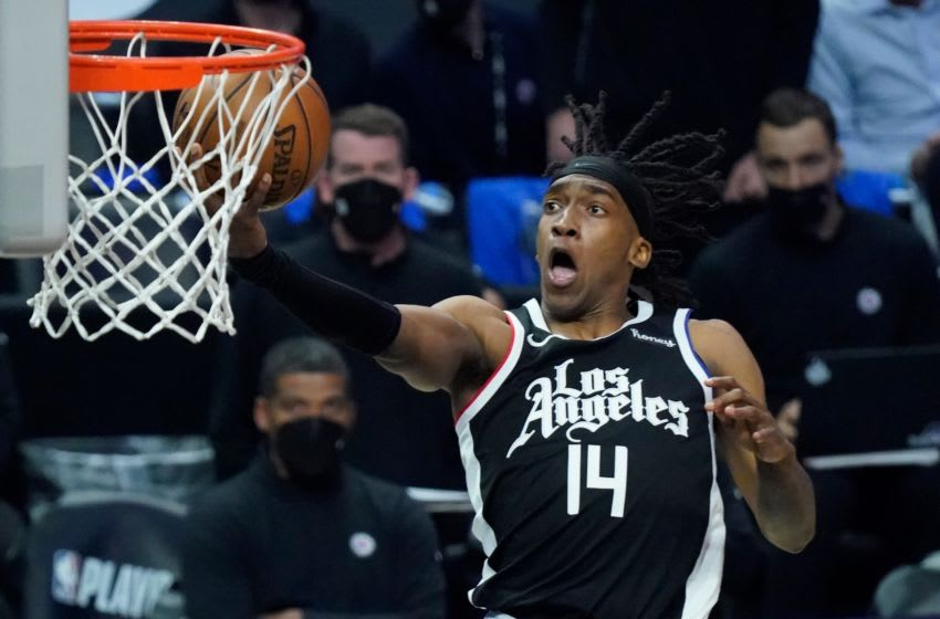 Jun 18, 2021; Los Angeles, California, USA; LA Clippers guard Terance Mann (14) scores on a breakaway during the third quarter of game six in the second round of the 2021 NBA Playoffs against the Utah Jazz at Staples Center. Mandatory Credit: Robert Hanashiro-USA TODAY Sports