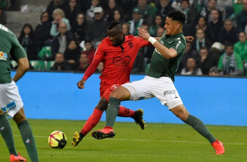 Nice's forward Igniatius Knepe Ganago (L) vies with Saint-Etienne's French forward William Saliba (R) during the French L1 football match Saint-Etienne vs Nice on May 18, 2019, at the Geoffroy Guichard Stadium in Saint-Etienne, central France. (Photo by JEAN-PHILIPPE KSIAZEK / AFP) (Photo credit should read JEAN-PHILIPPE KSIAZEK/AFP via Getty Images)