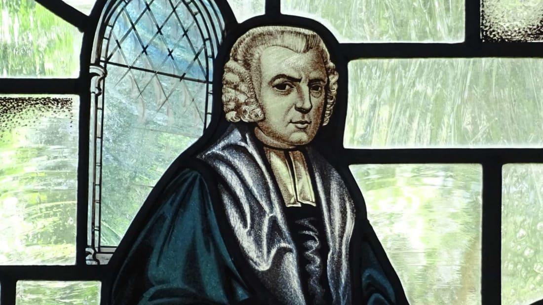 """A stained-glass image of John Newton, the man who wrote """"Amazing Grace."""""""