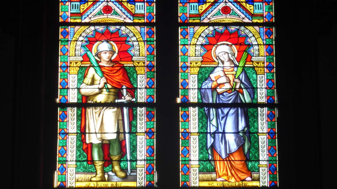 Stained-glass windows showing Saints Victor and Corona in Redeemer Church in Trentino, Italy.