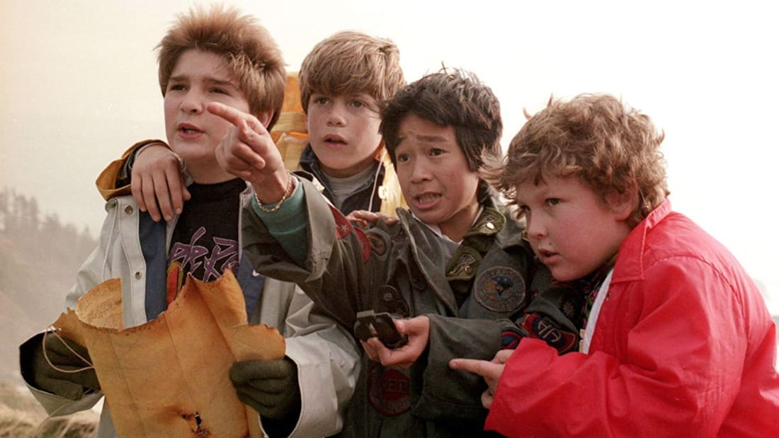 Corey Feldman, Sean Astin, Ke Huy Quan, and Jeff Cohen star in The Goonies (1985).