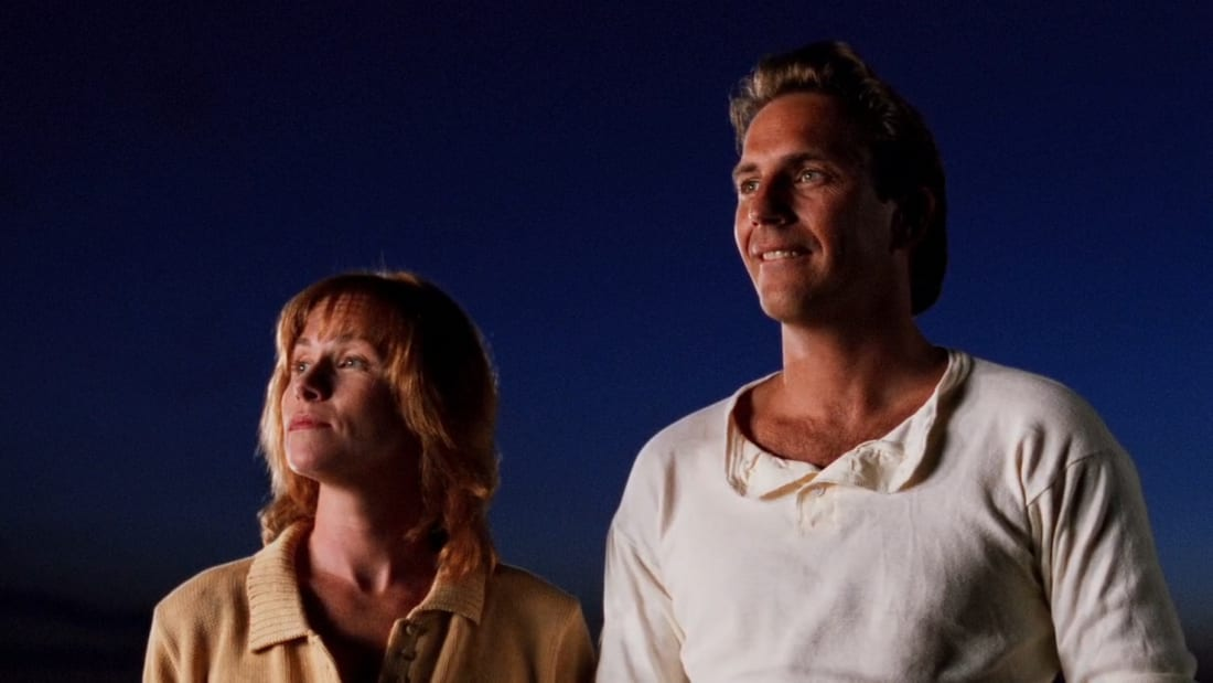 Amy Madigan and Kevin Costner star as Annie and Ray Kinsella in Field of Dreams (1989).