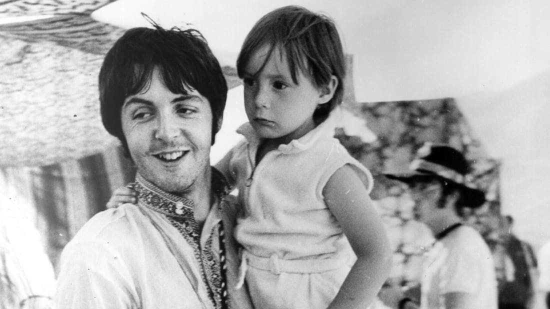 """Paul McCartney with John Lennon's son Julian, the inspiration for """"Hey Jude,"""" in Greece in the mid-1960s."""