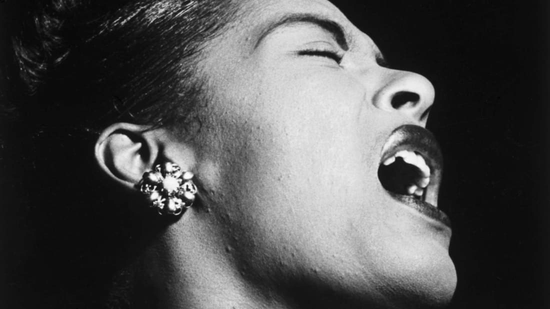 Billie Holiday performs at the Downbeat in New York City in 1947.
