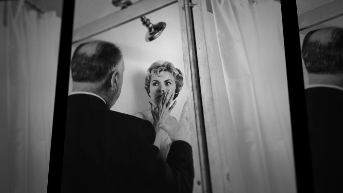 Alfred Hitchock directs Janet Leigh in Psycho (1960).