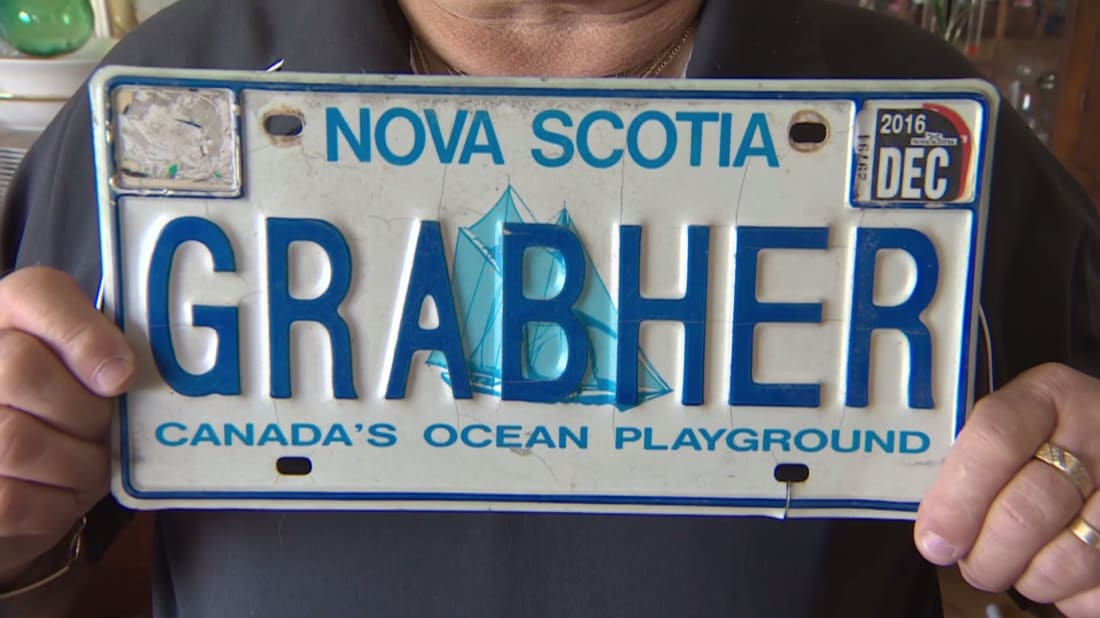 Lorne Grabher shows off his forbidden license plate.