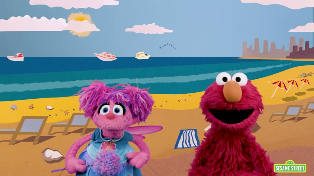 Elmo and Abby search for the color green at the beach.