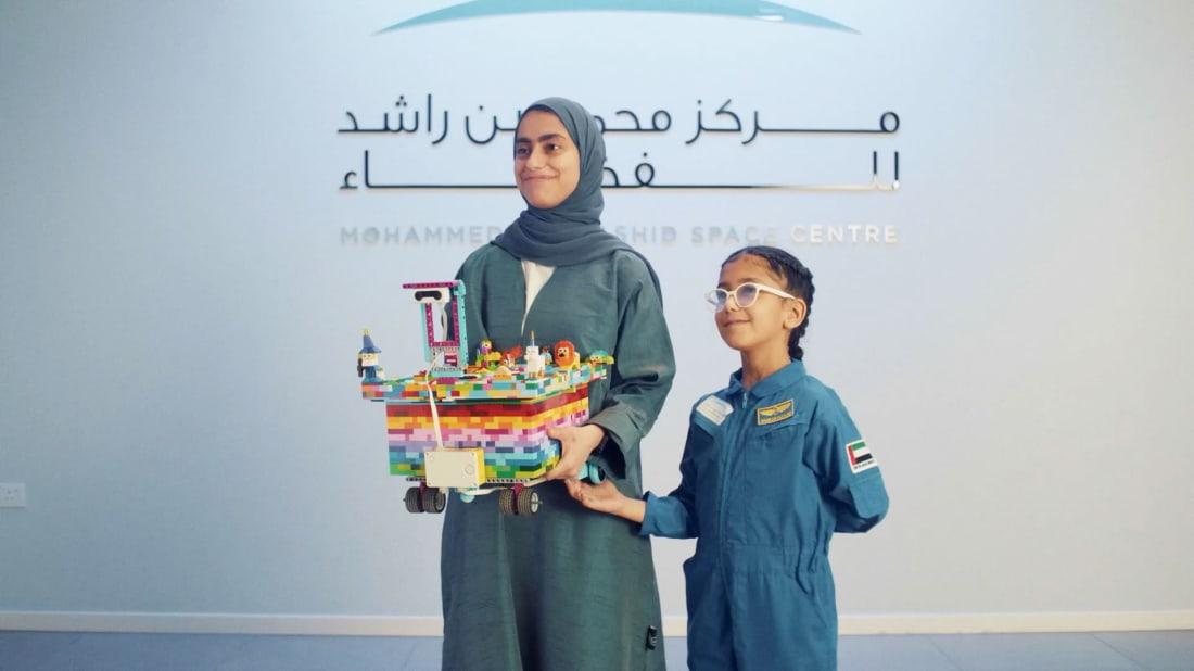 Fatima (left) and Shaika (right), high-aspiring, LEGO-loving sisters in the United Arab Emirates.