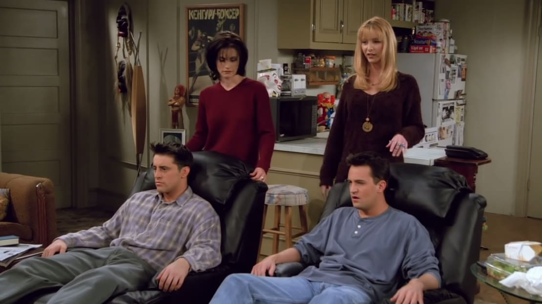 Joey and Chandler enjoy their new recliners during season 2 of Friends.