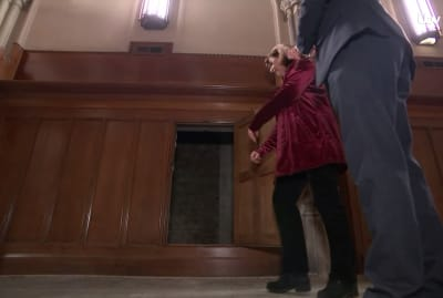 Historian Liz Hallam Smith shows off the a-door-able opening in the wall of Westminster Hall.