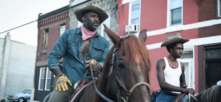 Idris Elba and Caleb McLaughlin star in Concrete Cowboy (2021).