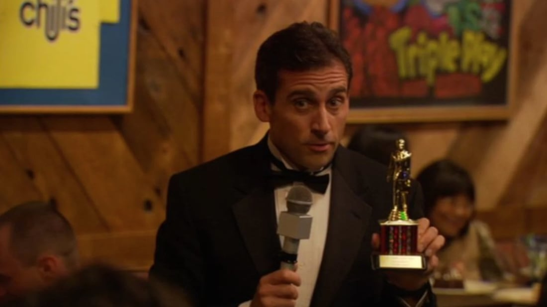 Steve Carell, as Michael Scott, hands out a well-deserved Dundie Award on The Office.