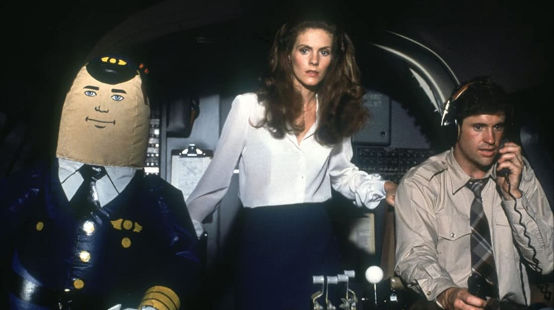 Julie Hagerty and Robert Hays (with Otto) in Airplane! (1980).