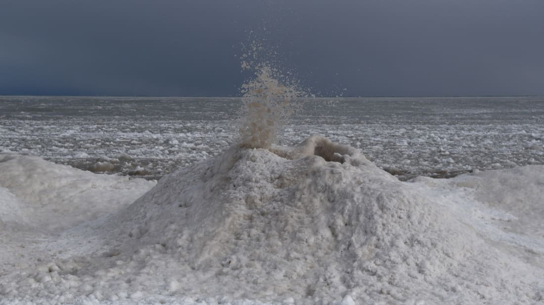 An 'ice volcano' erupts along Lake Michigan.