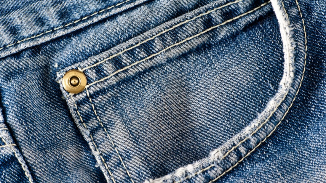 Jeans sometimes have a fake pocket. There are reasons for that, but not they're not necessarily good ones.