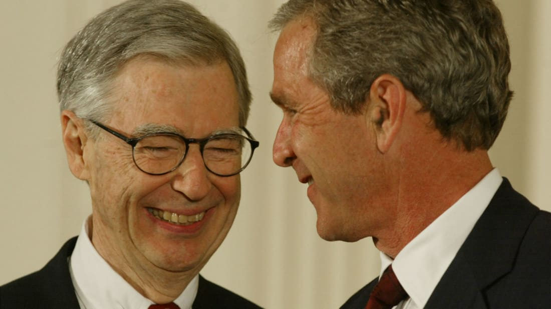 Mr. Rogers greets President George W. Bush in 2002.