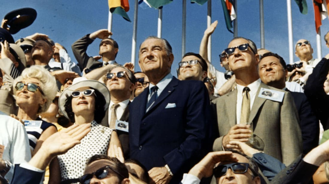 Vice President Spiro Agnew and former President Lyndon Johnson view the liftoff of Apollo 11