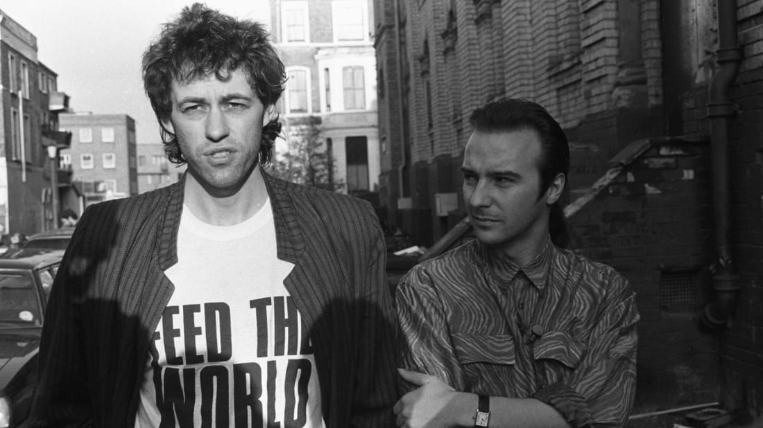 "Bob Geldof (L) and Midge Ure (R) outside a London recording studio while working on ""Do They Know It's Christmas?"" on November 25, 1984."