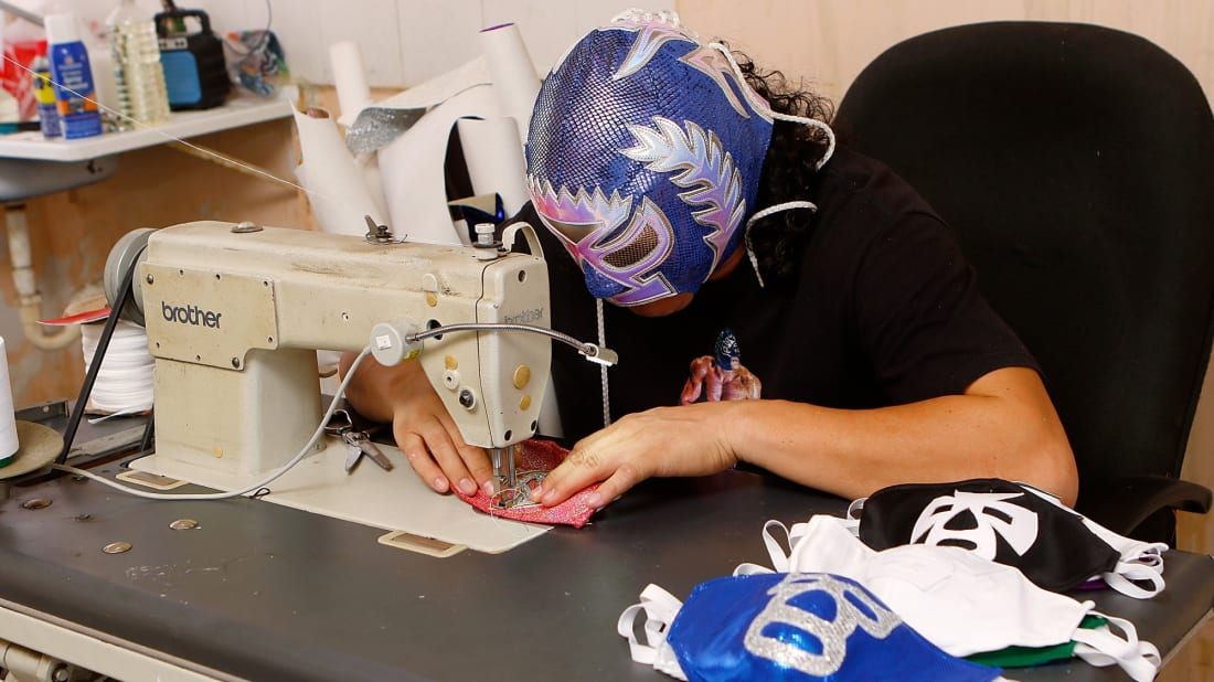 Lucha libre wrestler El Hijo del Soberano sews masks for the coronavirus pandemic.
