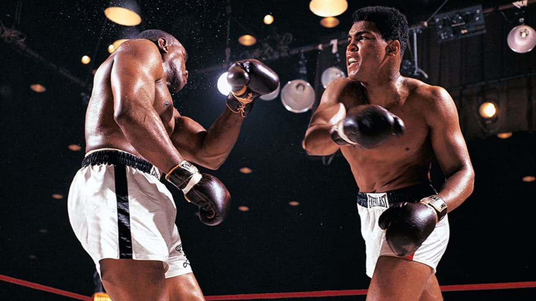 Sonny Liston (L) and Muhammad Ali (R) duke it out in 1964 in one of photographer Neil Leifer's legendary photos.