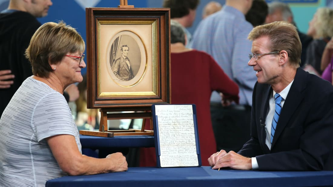 Appraiser Francis J. Wahlgren (R) examines a photograph inscribed by Abraham Lincoln on Antiques Roadshow.