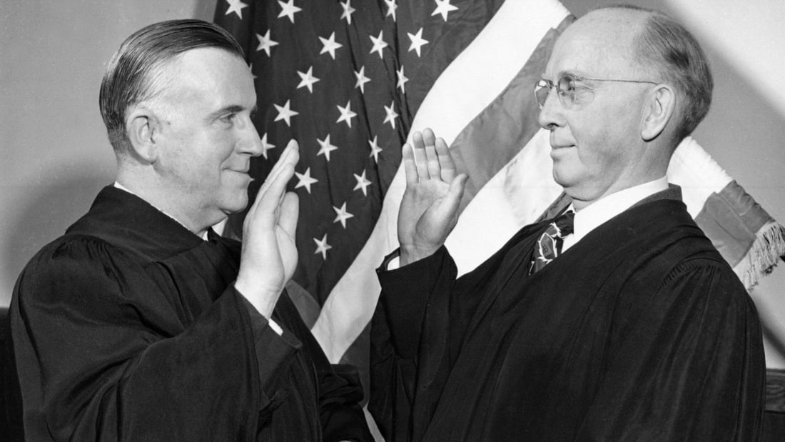 Judge Thomas Patrick Thornton (left) is sworn in as a federal judge by Judge Arthur F. Lederle (right) on February 15, 1949.