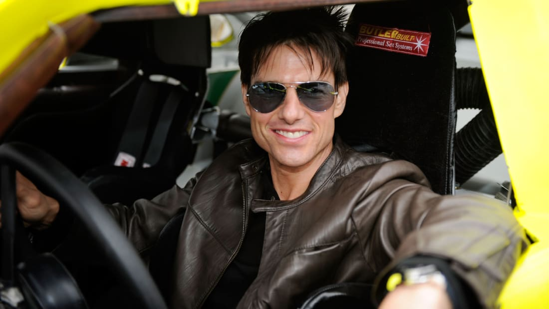 Tom Cruise feels the need for speed. And Ray-Bans.