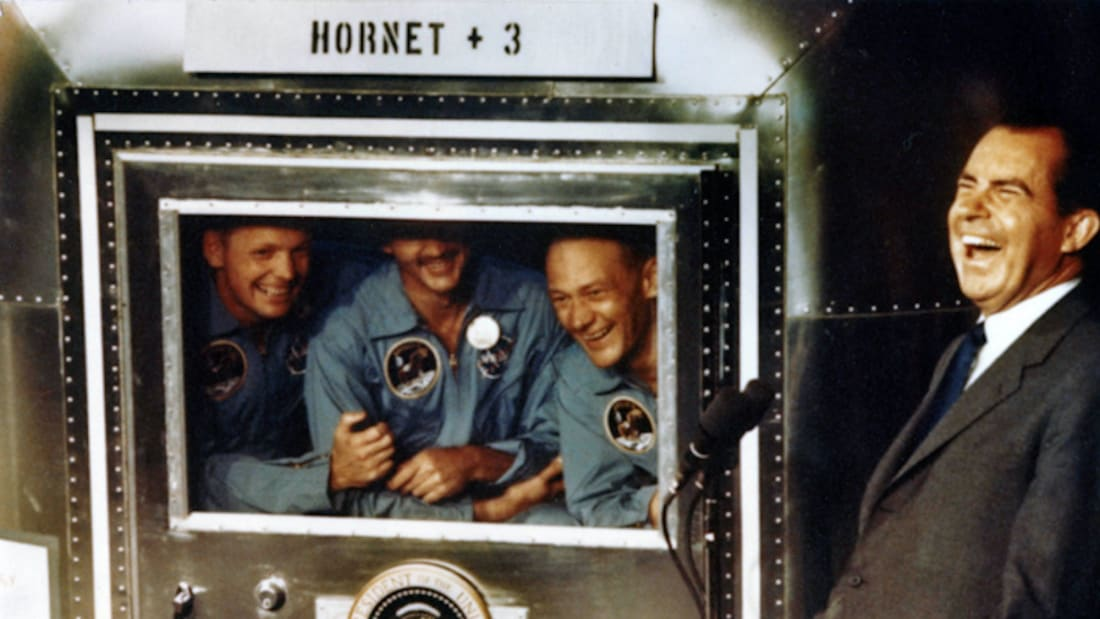 Neil Armstrong, Michael Collins, and Buzz Aldrin share a laugh with President Richard Nixon while aboard the USS Hornet on July 24, 1969.