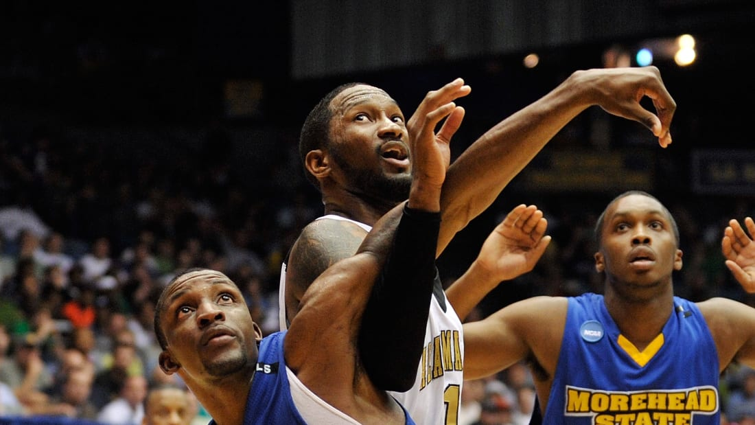 The Morehead State Eagles and Alabama State Hornets battle for a rebound.