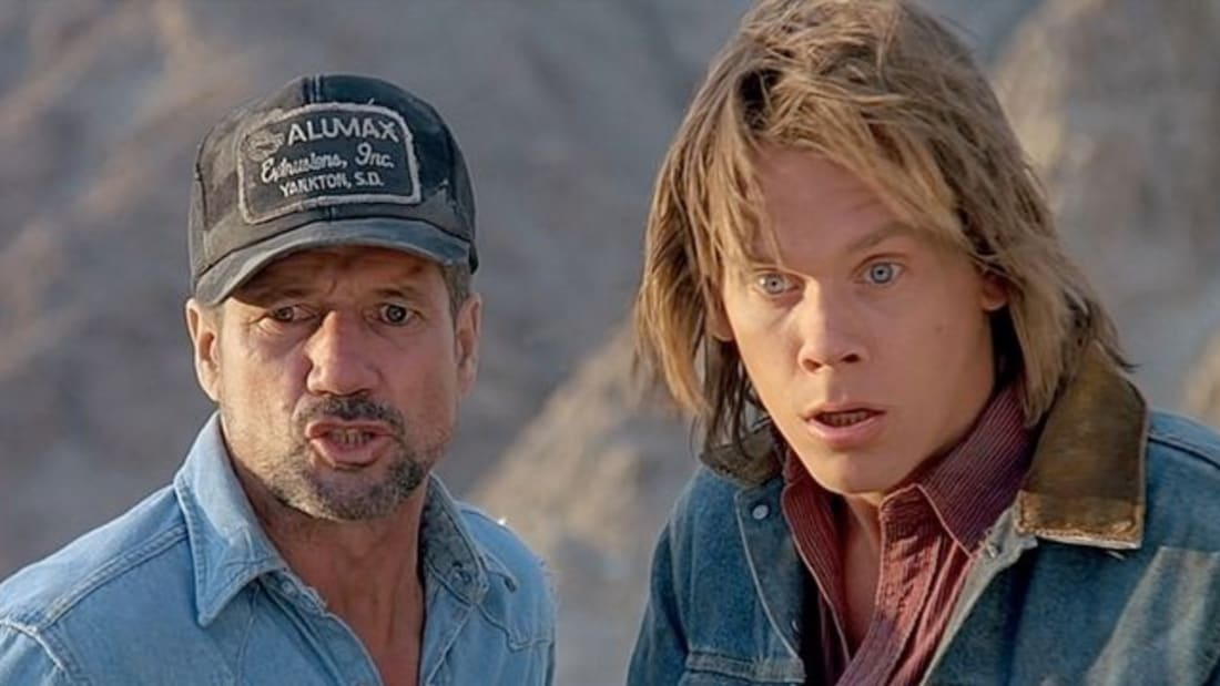 Fred Ward and Kevin Bacon in Tremors (1990).