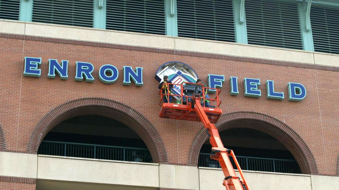 Houston Astros employees remove the Enron logo sign from Astros Field