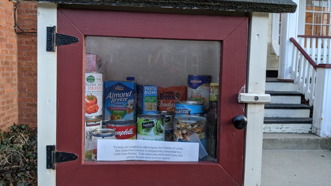 A Little Free Library full of canned goods in Chicago.