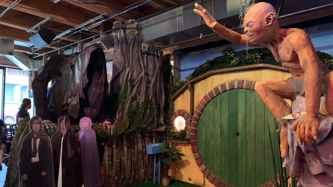 Gollum and a Ringwraith loom near Bilbo's hobbit hole at Replay Lincoln Park's Lord of the Rings pop-up bar.