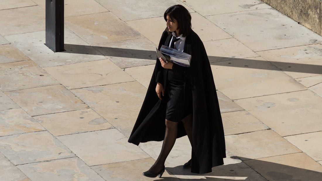A Coimbra university student in uniform, cloak and all