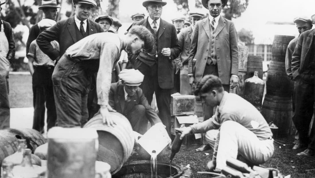The sheriff of Orange County, California, dumping bootleg booze during Prohibition