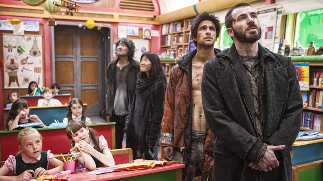 Chris Evans, Luke Pasqualino, Ko Asung, and Kang-ho Song in Snowpiercer (2013).