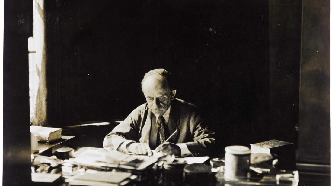 J.M. Barrie at his desk in Adelphi Terrace House.