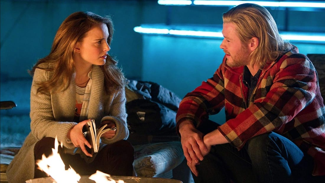 Natalie Portman and Chris Hemsworth in Thor (2011).
