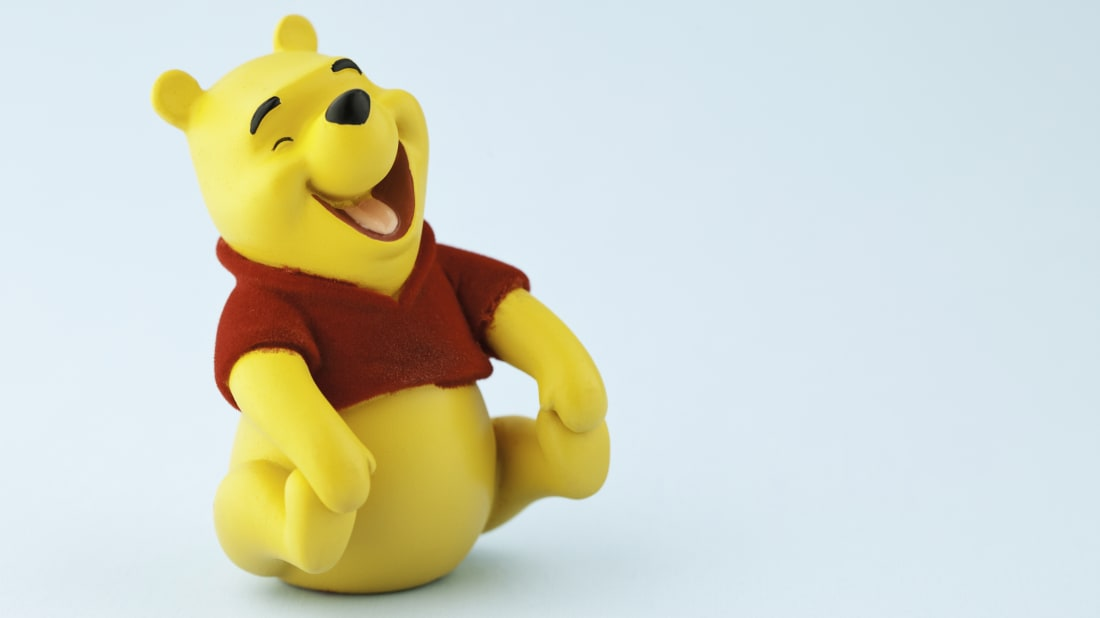 It is a graphic of Gratifying Whinne the Pooh Pics