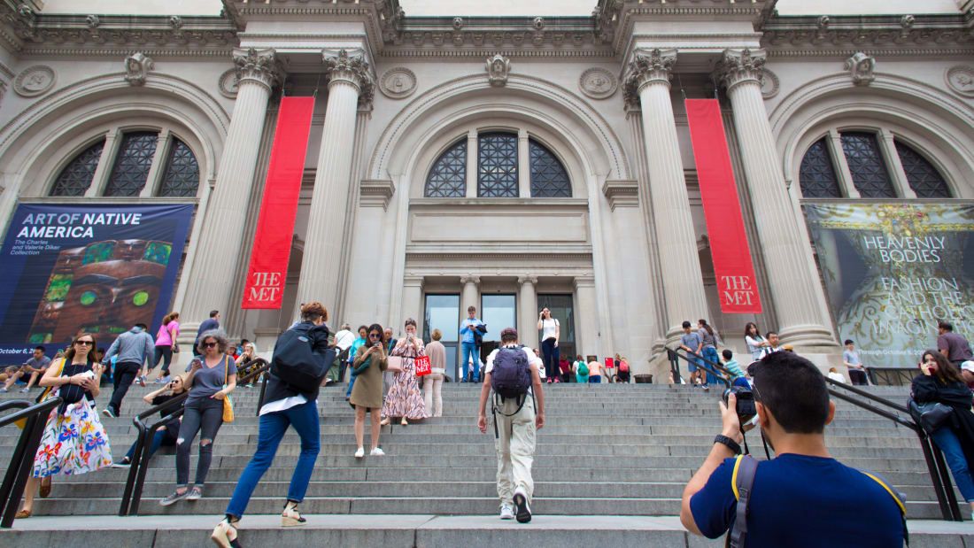 A crowd on the steps of the Metropolitan Museum of Art