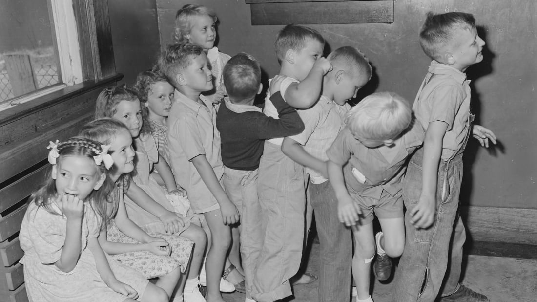 Preschoolers waiting to be vaccinated for smallpox outside their doctor's office.