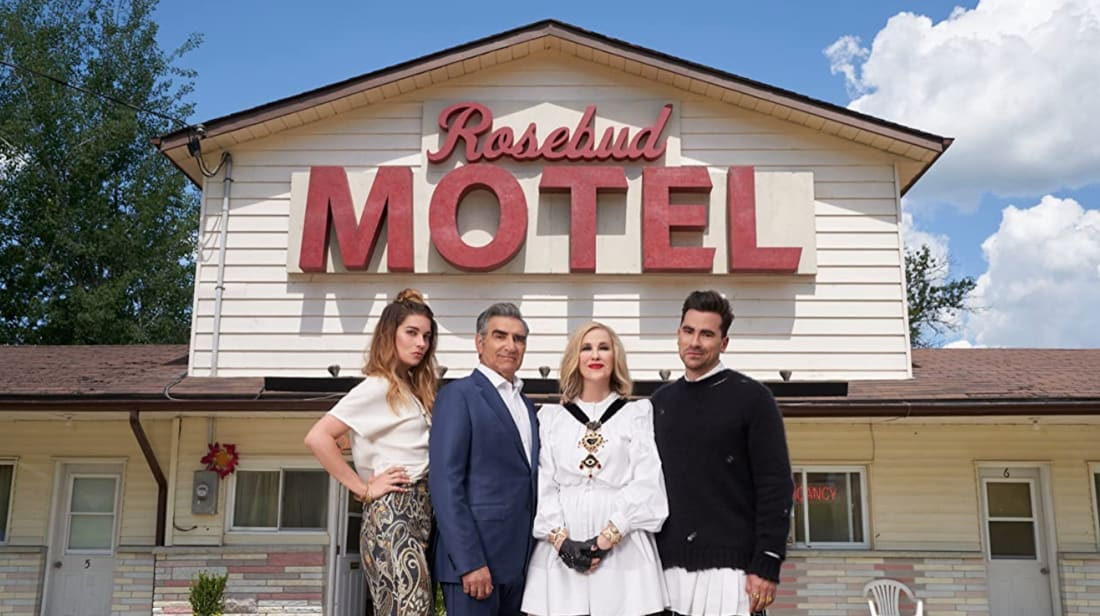 Annie Murphy, Eugene Levy, Catherine O'Hara, and Dan Levy pose outside the Rosebud Motel on Schitt's Creek.