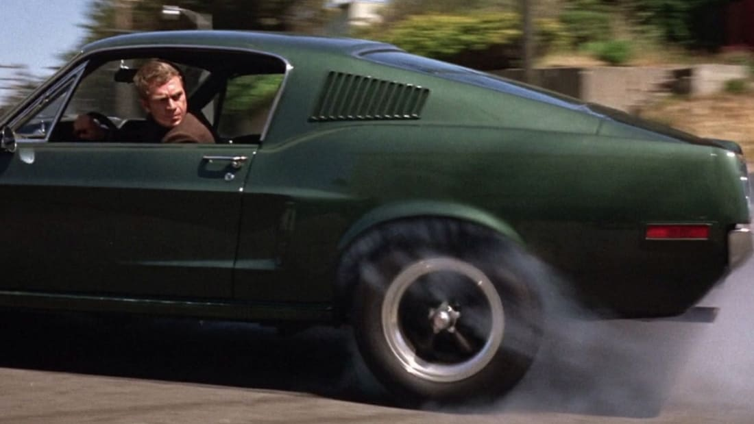 Steve McQueen drives a 1968 Ford Mustang Fastback in Bullitt (1968).