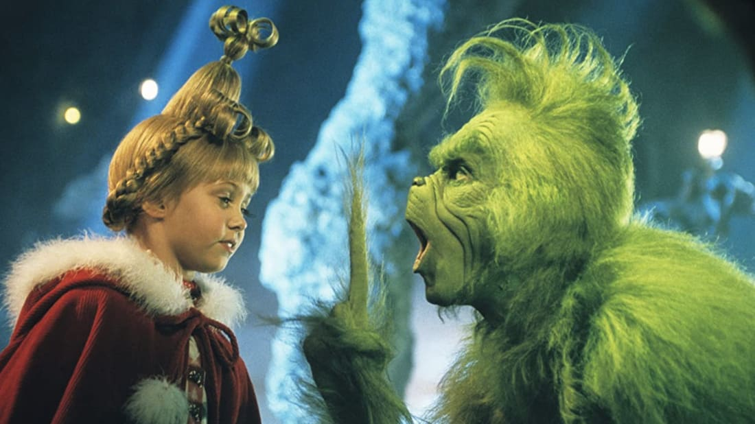 Taylor Momsen and Jim Carrey in How the Grinch Stole Christmas (2000).